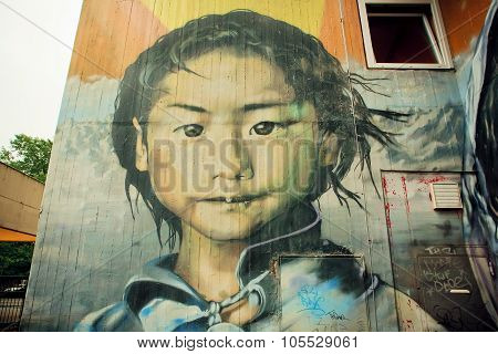 Graffiti with poor girl face,