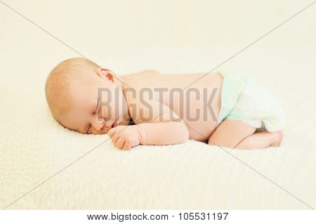 Baby Sweet Sleeping On His Stomach On Bed At Home