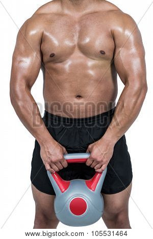 Muscular man lifting heavy kettlebell on white background