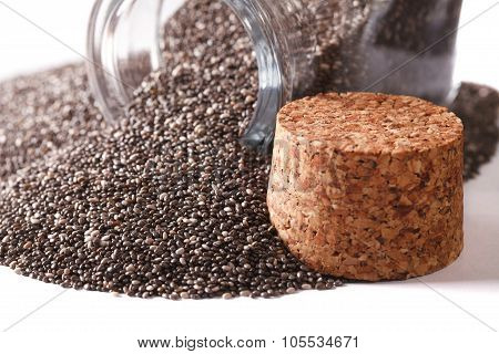 Useful Chia Seeds Spill Out Of A Jar Macro Isolated On White. Horizontal