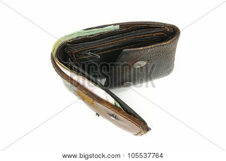 Old brown leather wallet and bank notes isolated on white background