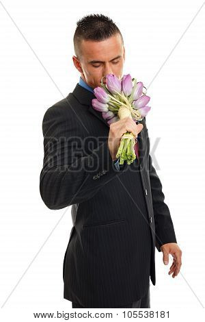 Man in suit with tulips