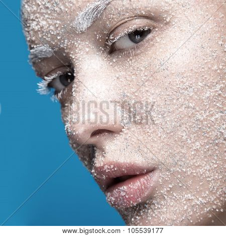 Portrait Of Girl With Pale Skin And Sugar Snow On Her Face. Creative Art Beauty Fashion.