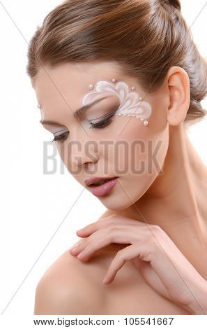 portrait of beautiful caucasian young woman with pearl glamour make-up