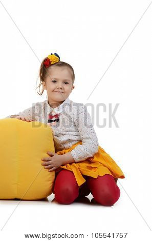 Studio portrait of cute little girl  with colour cubes on white background