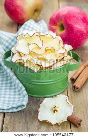 Healthy Snack. Homemade Dehydrated Apple Chips On Rustic Wooden Background