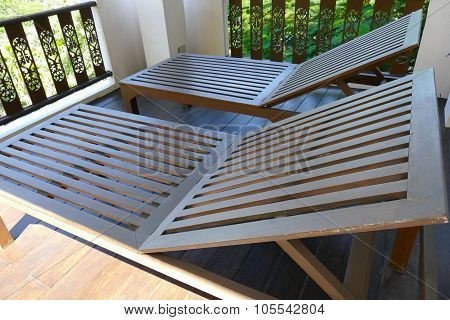 Wooden Deckchair At The Balcony
