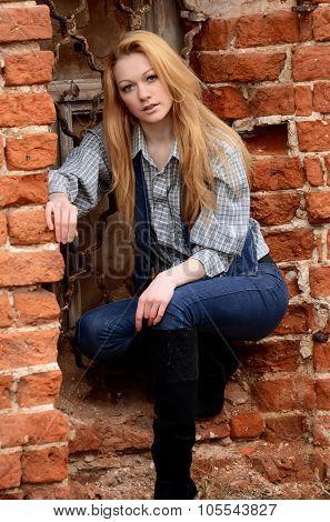 The beautiful woman at old brick wall