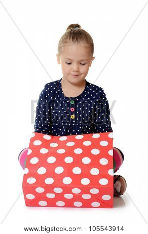 The little girl with a packages isolated