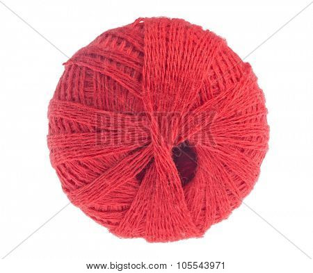 clew of red thread isolated on white background