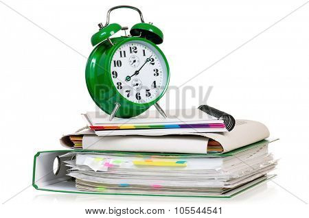 Big green alarm clock with folders, isolated on white background