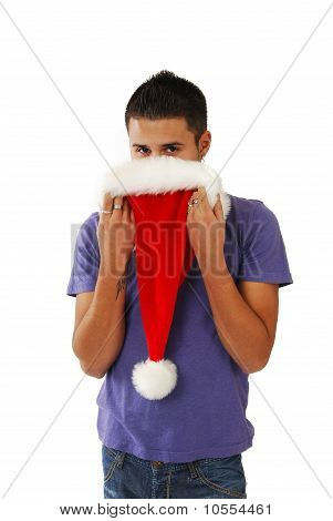 Young Hispanic Man Hiding Behind A Santa Hat