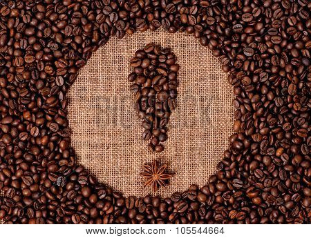 Exclamation point made of coffee beans on the old burlap
