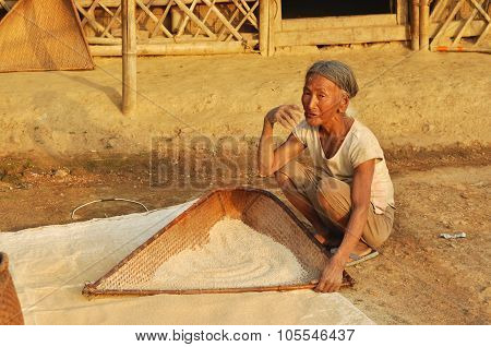 Old Woman Sifting Flour In Nagaland, India