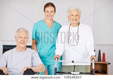Two old senior people in nursing home with a geriatric nurse
