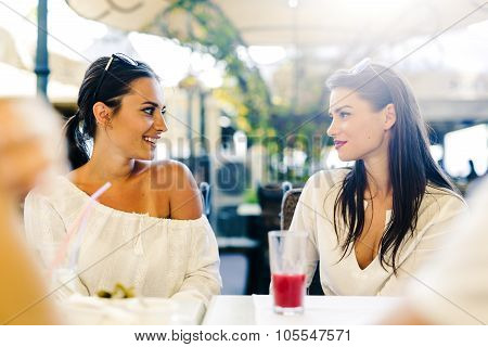 Two Young Girls Talking During Lunch Break