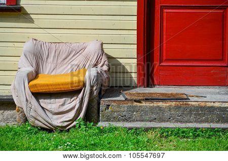 Old shabby armchair