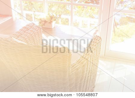 Rattan Armchair With Fabric Cushion And Pillow Near The Window With Garden View (color Filter And So