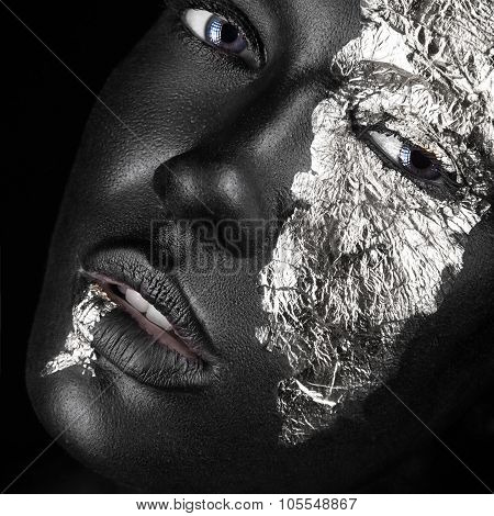 Fashion Portrait Of A Dark-skinned Girl With Silver Foil Make-up. Beauty Face.