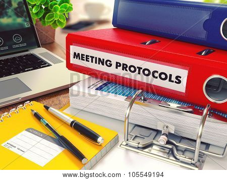 Meeting Protocols on Red Office Folder. Toned Image.
