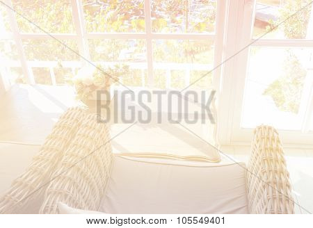 Rattan Armchair With Fabric Cushion Near The Window With Garden View (color Filter And Soft Focus)
