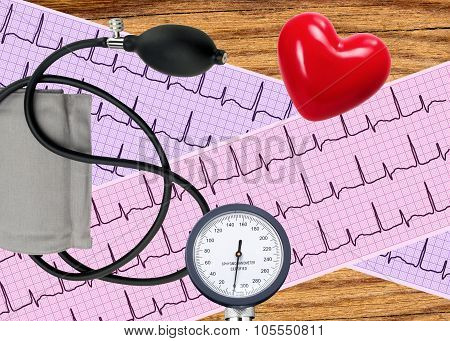 Heart Analysis, Electrocardiogram Graph And Blood Pressure Meter Over Wooden Background