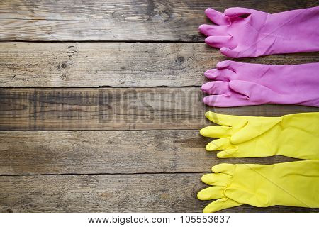 Latex Cleaning Gloves On Wooden Table