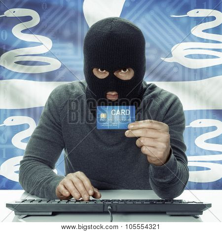 Dark-skinned Hacker With Flag On Background Holding Credit Card - Martinique