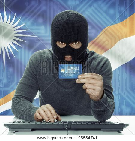 Dark-skinned Hacker With Flag On Background Holding Credit Card - Marshall Islands