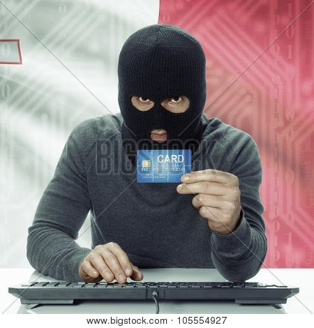 Dark-skinned Hacker With Flag On Background Holding Credit Card - Malta