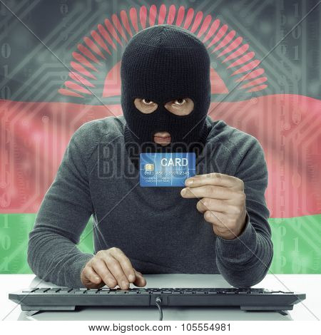 Dark-skinned Hacker With Flag On Background Holding Credit Card - Malawi
