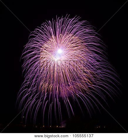Pink purple violet amazing fireworks isolated in dark background close up with the place for text