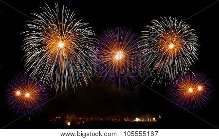 Colorful fireworks over night sky,red fireworks lines in black background and city view