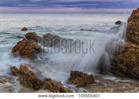 Splash And Spray Of Waves Against The Rocks. Sunset On The Sea.