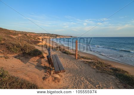 Bench at sunset at Crystal Cove Beach