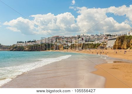 Waves On The Beach In Albufeira Fishermen. Portuguese Tourist Town.