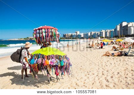 RIO DE JANEIRO, BRAZIL - APRIL 28, 2015: Brazilian street vendors sells swimsuit on April 28, 2015 at Copacabana Beach, Rio de Janeiro. Brazil.