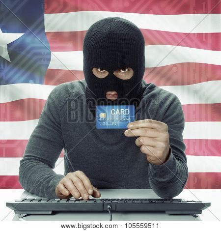 Dark-skinned Hacker With Flag On Background Holding Credit Card - Liberia