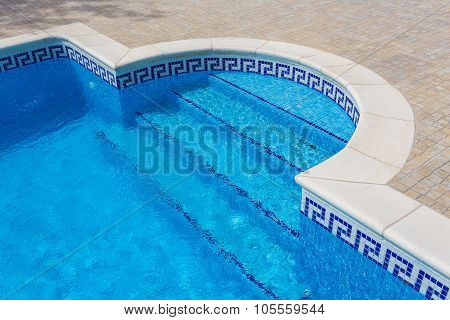 Entrance To The Pool Of Marble, Tiles, With Clear Water. In The Summer Swimming Tourists.