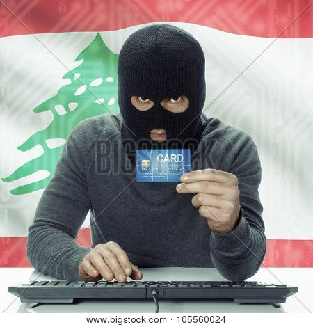 Dark-skinned Hacker With Flag On Background Holding Credit Card - Lebanon