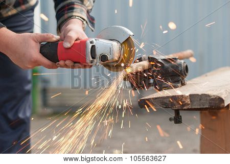 Man Cuts A Metal Pipe Power Saw.