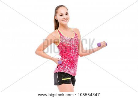 Young smiling sportswoman in pink top and black shorts  exercising with weights