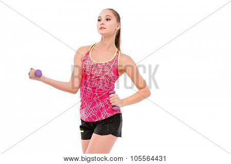 Beautiful athletic sportswoman with hand weights doing exercises