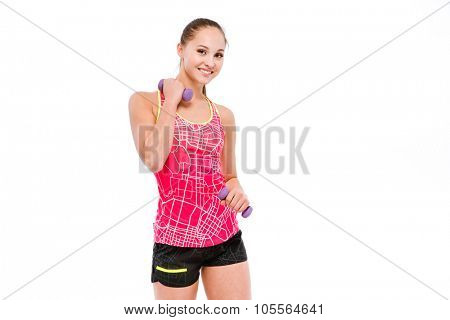 Young smiling beautiful sportswoman in pink top and black shorts exercising with dumbbells