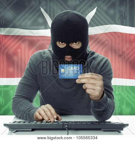 Dark-skinned Hacker With Flag On Background Holding Credit Card - Kenya