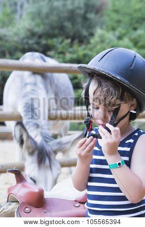 Young Rider Fits His Helmet.