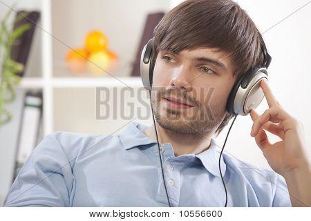 Man Hearing Music At Home