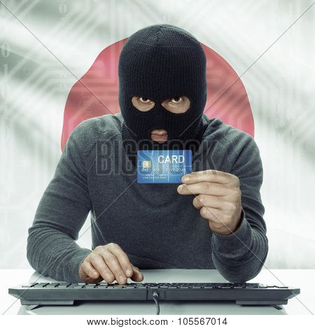 Dark-skinned Hacker With Flag On Background Holding Credit Card - Japan