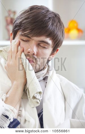 Man With Toothache At Home