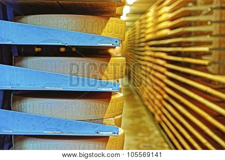 Round Stacks Of Cheese Stored On Shelves Of The Maison Du Gruyere Cheese Factory